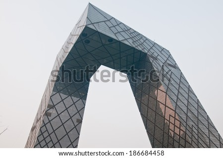 BEIJING, CHINA - MARCH 30: CCTV Headquarters of China Central Television on East Third Ring Road, Guanghua Road in Beijing Central Business District (CBD) on March 30, 2013 in Beijing - stock photo