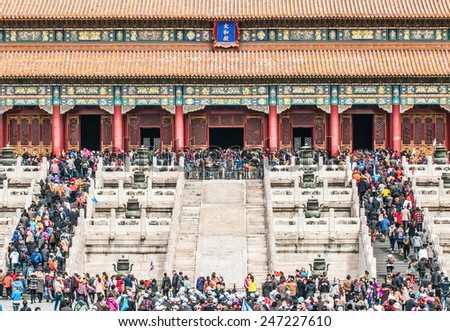 BEIJING, CHINA - MARCH 28: Chinese and foreign tourists in front of Hall of Supreme Harmony (Taihedian) on the Outer Court of Frobidden City on March 28, 2013 in Beijing - stock photo