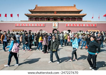 BEIJING, CHINA - MARCH 27: Chinese tourists in front of Gate of Heavenly Peace (Tiananmen) on March 27, 2013 in Beijing - stock photo