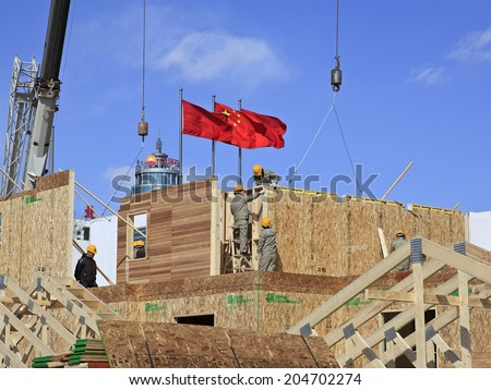 BEIJING, CHINA-MARCH. 24, 2011: Construction workers are seen on site. In China, it's estimated that, 90% of the 40 million construction workers were migrant workers at the end of 2006 - stock photo