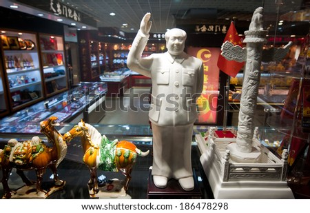 BEIJING, CHINA - MARCH 28: figures of camel, horse, Mao Zedong and Huabiao column in souvenir shop on Guanchang East Side Road near Tiananmen Square on March 28, 2013 in Beijing - stock photo