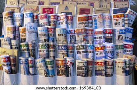BEIJING, CHINA - MARCH 12, 2012: Newspapers on sale in a newsstand in Beijing. In 2013 China ranked at position 173 out of 179 in the Press Freedom Index. - stock photo