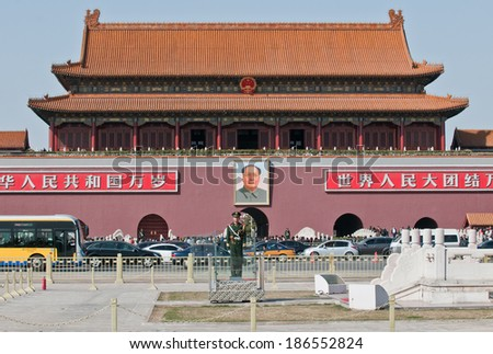 BEIJING, CHINA - MARCH 27: soldiers stands at attention on Tiananmen square in front of Gate of Heavenly Peace (Tiananmen) on March 27, 2013 in Beijing - stock photo