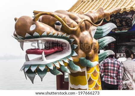 BEIJING, CHINA-MARCH 2014:-The summer palace bathed in Smog, home for the Dragon Lady, March 2014 in Beijing. The summer Palace was used as a beautiful prison for the empress Dragon ladys Nephew.