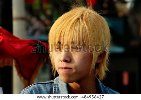 Beijing, China - May 5, 2005:  Trendy Chinese youth with bleached blond hair at the Shi Sa Hai Hutong