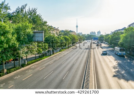 BEIJING, CHINA 21 MAY 2016, view on the broad roads of Beijing on a sunny day with low smow level on 21 May 2016 - stock photo