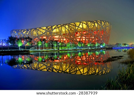 BEIJING, CHINA, November 14: National Stadium (Bird's Nest) on the evening of November 14, 2008, a symbol of modern China attracting million of tourists each year. - stock photo