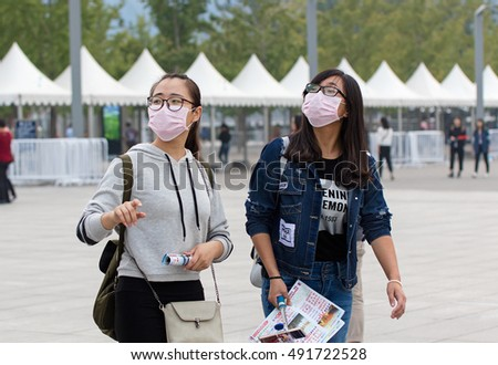 BEIJING, CHINA - OCTOBER 1, 2016: People using facemasks at the Olympic Green during the National Day holiday, celebrating the 67th anniversary of the founding of the People's Republic of China