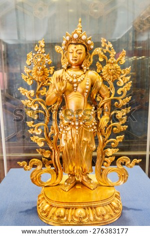 Beijing, China - on March 21, 2015, the Palace Museum exhibition of exquisite qing dynasty  Gold Buddha