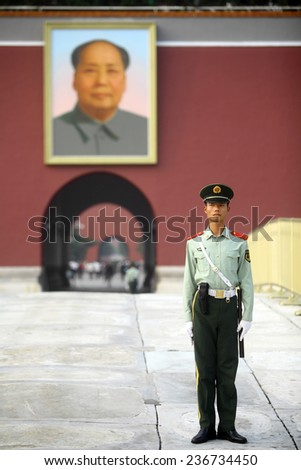 Beijing, China - September 25, 2014:  A soldier stands guard at Tiananmen Square, near a portrait of Mao Zedong, in Beijing, China.