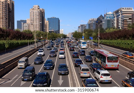 BEIJING, CHINA - SEPTEMBER 12, 2015: City skyline and Traffic on second ring road; It's reported that Beijing had the worst traffic congestion in China in the second quarter. - stock photo