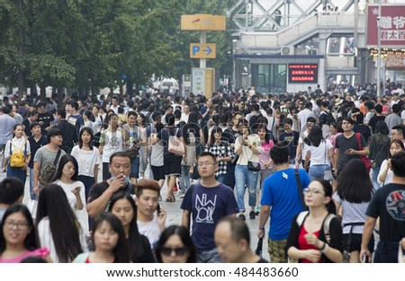 BEIJING, CHINA SEPTEMBER 16, 2016:  Unidentified people crowd Xidan commercial area during the Mid-Autumn Festival holiday.