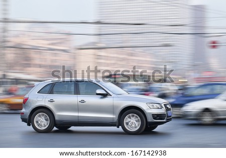 BEIJING-DEC. 6. Audi Q5 SUV. Audi controls 30% of the Chinese market, its rival BMW controls 24%, Audi now sells almost twice as many vehicles in China as it does in Germany. Beijing, Dec. 6. 2013. - stock photo