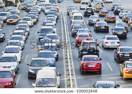 BEIJING - DEC. 19, 2011. Daily traffic jams in Beijing on Dec. 19, 2011. There are already 4.7 million cars on Beijing's streets. Recently the government took tough measures avoid a double by 2015. - stock photo