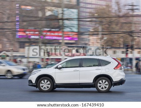BEIJING-DEC. 6. Honda CR-V SUV. To win back lost territories in China, Japanese automaker Honda Motor Co announced plans on June 14 to introduce 12 new models to China by 2015. Beijing, Dec. 6, 2013. - stock photo