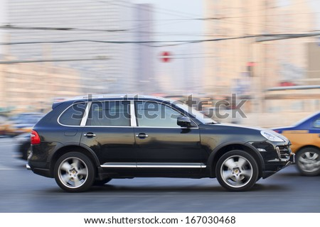 BEIJING-DEC. 6. Porsche Cayenne SUV. China is Porsche's second-largest market after the US. It expect sales will continue expand as it doubles its dealership network by 2016. Beijing, Dec. 6, 2013. - stock photo