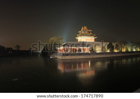 BEIJING - DECEMBER 22: night view of northeast turrets of the Forbidden City on december 22, 2013, beijing, china.
