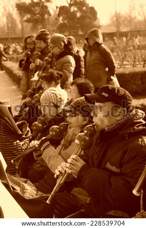 BEIJING - DECEMBER 22: Old people were playing hulus in the Jingshan Park, December 22, 2013, Beijing, China.   - stock photo
