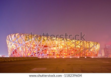 BEIJING - FEB 21: Beijing National Stadium, also known as the Bird's Nest, at dusk on February 21, 2012 in Beijing, China.The 2015 World Championships in Athletics will take place at this famous venue - stock photo