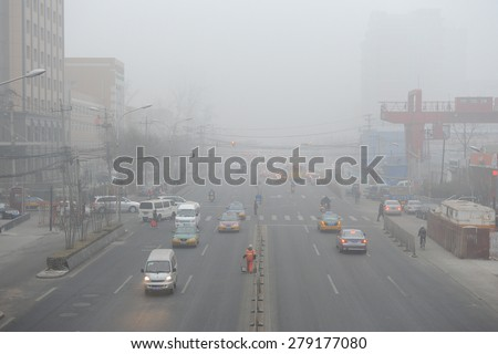 BEIJING - FEB 28: severe air pollution in Beijing city center on February 28, 2013 in Beijing, China. Beijing has an alarming level of air pollution (AQI >500), one of the highest in the world. - stock photo