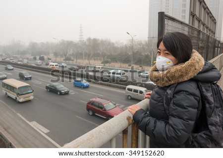 """BEIJING - FEB 25: severe air pollution on February 25, 2014 in Beijing, China. Air quality index levels were classed as """"Beyond Index"""" (PM 2.5 of over 500 micrograms per cubic meter).  - stock photo"""