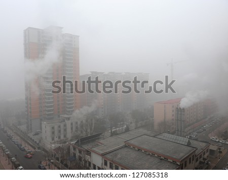 """BEIJING - JAN 12: Severe air pollution on January 12, 2013 in Beijing, China. Air quality index levels were classed as """"Beyond Index"""" (PM 2.5 of over 700 micrograms per cubic meter). - stock photo"""