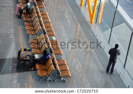 BEIJING-JANUARY. 15. Beijing Capital Airport Terminal 3. The world's largest airport terminal-building complex measures 986,000 m2 floor surface. Beijing,  China January. 15, 2014 - stock photo