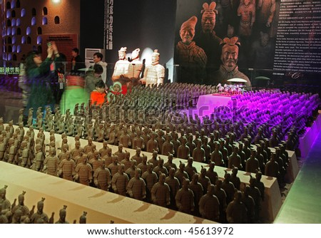 BEIJING - JANUARY 30: Visitors look at the army of chocolate-made terra-cotta warriors at the World Chocolate Dream Park on January 30, 2010 in Beijing, China. - stock photo