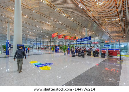 BEIJING JULE 30, Air Crew checking at immigration, Beijing airport  on June 30, 13 in Beijing . The airport has registered 488,495 annually aircraft movements and ranked 10th in the world. - stock photo