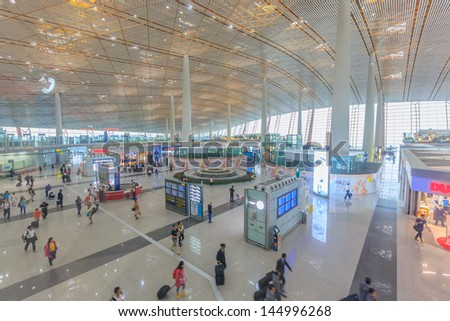 BEIJING JULE 30, Duty fee shopping area at Beijing airport  on June 30, 13 in Beijing. The airport has registered 488,495 annually aircraft movements and ranked 10th in the world. - stock photo