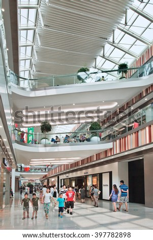 BEIJING-JULY 18, 2015. Inside Livat shopping mall. At over 172,000 sq. meters, LIVAT stands out from other malls in Beijing, not only by size, but for being invested, owned by Inter IKEA Center Group. - stock photo