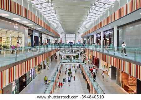 BEIJING-JULY 18, 2015. Inside Livat shopping mall. Owned by Inter Ikea Centre Group, its design is uniquely Scandinavian with a spacious atrium for visitors searching for a unique airy indoor space.  - stock photo