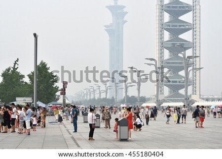 BEIJING - JULY 17: people visit the busy Beijing Olympic Park area on 17 July, 2016 in Beijing, China. Beijing is a fast growing metropolis with a population of over 21 million people in 2016. - stock photo