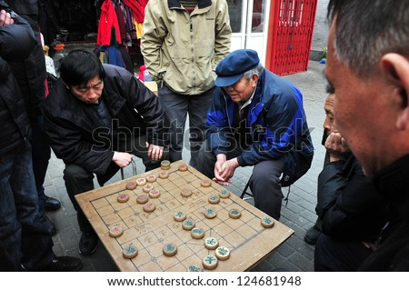 BEIJING - MAR 14:Chinese people play Xiangqi (Chinese Chess) in Beijing,China on March 14 2009.It's one of the most popular board game in the world, played by millions of people in China and Asia. - stock photo