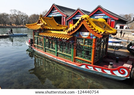 BEIJING - MAR 14:Decorated Chines boat over Kunming Lake at the Summer Palace in Beijing China on March 14 2009. The Summer Palace is the best preserved imperial garden in the world. - stock photo