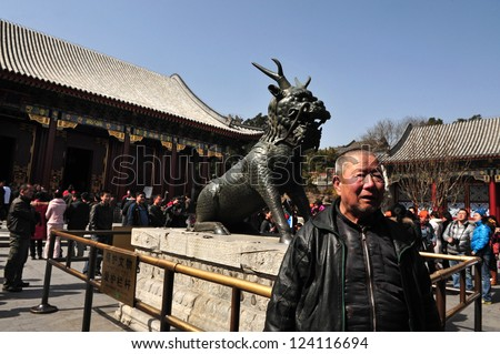 BEIJING - MAR 14:Visitors near a Chinese dragon at the Summer Palace.t The Summer Palace in Beijing China on March 14 2009.The Summer Palace is the best preserved imperial garden in the world. - stock photo