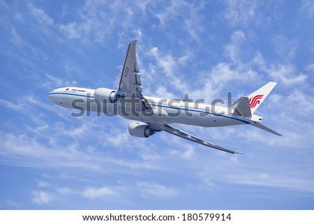 BEIJING-MARCH 6, 2014. Air China Boeing 777-300, B-2037 in the air. It is the World's largest twinjet with typical seating capacity for 314 to 451 passengers and a  range of 9,695 to 17,372 km.