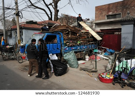 BEIJING - MARCH 11:Chinese people recycling material in a Hutong (old neighbourhood) on March 11 2009 in Beijing, China.There is around 4,000 Hutongs in Beijing some are hundreds of years old