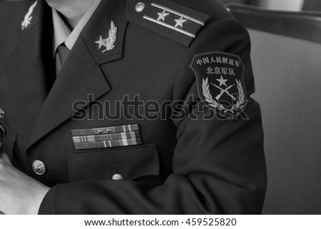 "BEIJING - MARCH 11: ""Chinese people's liberation army (PLA), Beijing military area command "" written on book of uniform armbands, March 11, Beijing, China."