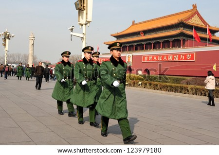 BEIJING - MARCH 11:Chinese soldiers march in Tiananmen square on March 11 2009 in Beijing,China.It's the third largest square in the world and important site in Chinese history - stock photo