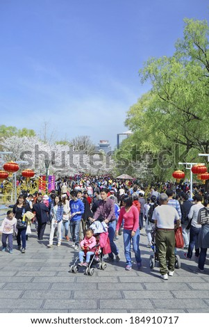 BEIJING-MARCH 30, 2014. Crowd at Yuyuantan Park. Spring cherry tree blossom attracts thousands of tourists. The park covers an area of 136.69 hectares and water surface spans an area of 61 hectares.