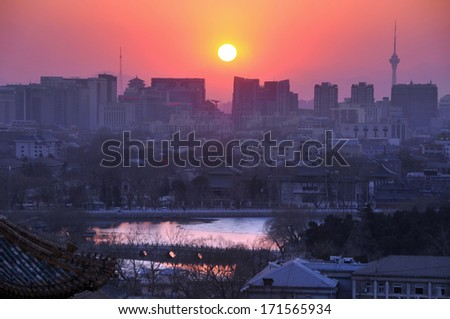 Beijing-March 4, 2013: Panoramic view of Central Business District in Beijing with sun set on March 4, 2013  - stock photo