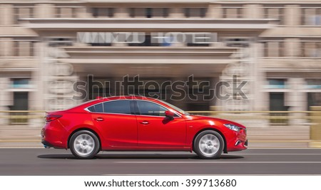 BEIJING-MARCH 30, 2016. Red Mazda 6 sedan. Mazda's sales in China delivered a meager rise of 1.2% year on year to 15,983 units. Mazda models 3, 6 and CX-5 were the three best sellers in China. - stock photo