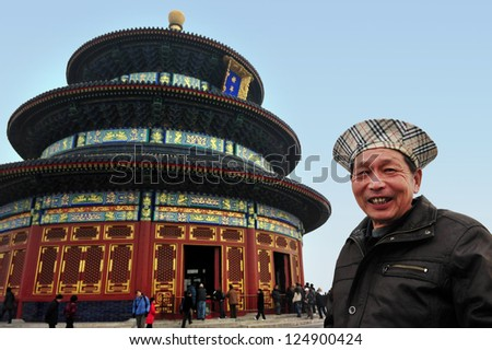 BEIJING - MARCH 15: Unidentified Chines man visits at the Temple of Heaven on Mar 15 2009 in Beijing, China. The Temple of Heaven is regarded as one of the Beijing's Top 10 tourist attractions. - stock photo