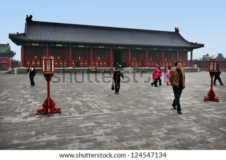 BEIJING-MARCH 15: Visitors at the Temple of Heaven on Mar 15 2009 in Beijing, China. The Temple of Heaven is regarded as one of the Beijing's Top 10 tourist attractions. - stock photo