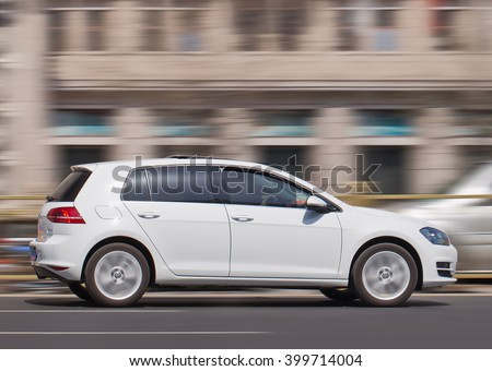 BEIJING-MARCH 30, 2016. White Volkswagen Golf. Volkswagen world-wide sales declined in 2015 for the first time since 2002 in the wake of an emissions-cheating scandal that hit the company recently. - stock photo