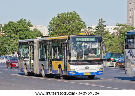 BEIJING-MAY 29, 2013. Bendi on Chang an Avenue. In 2013, the state-owned Beijing Public Transport Holdings, operated 1,020 bus routes, 22,555 buses and trolleybuses which delivered 4.63 billion rides - stock photo