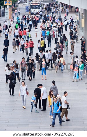 BEIJING-MAY 21, 2013. Crowd at Xidan shopping area. China's population is 1,393,783,836 as of July 1, 2014, the equivalent to 19.24% of world's total. China ranks number 1 in the world by population.