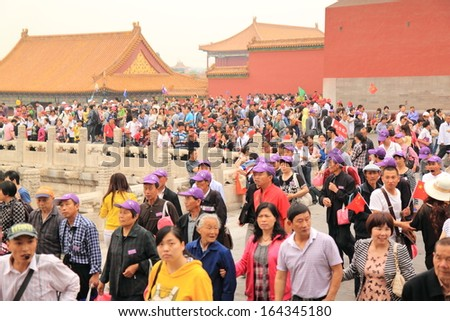 Beijing  - May 11: Tourists sightsee in Forbidden City - May 11,2012 in Beijing China. The emergence of a newly rich middle class is fueling domestic travel boom  - stock photo