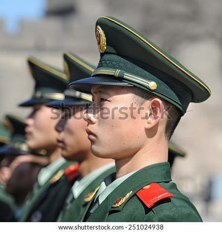 BEIJING - NOV 8: Soldiers stand guard in Tiananmen area during China's 18th National Congress on November 8, 2012 in Beijing, China.Security is extra tight because of leadership transition.  - stock photo